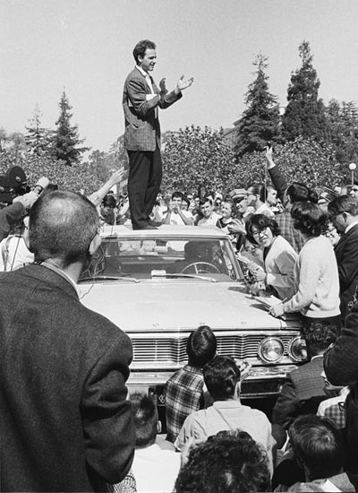 Mario Savio speaking from the top of the police car.