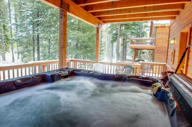 A jacuzzi tub the size of a pool, on the deck!