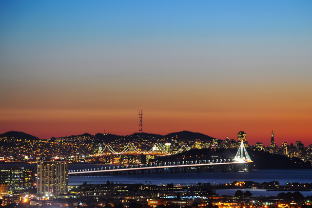 Beautiful Sunset over the New Bay Bridge and San Francisco. Photo: http://www.joelthaiphotography.com