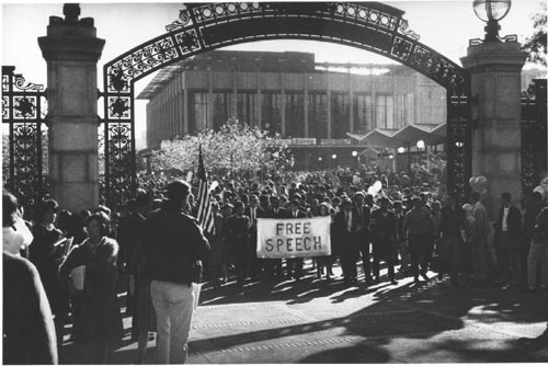 """Group carrying """"Free Speech"""" banner through Sather Gate [ca. 1965]. Credit: Courtesy of UC Berkeley, The Bancroft Library"""