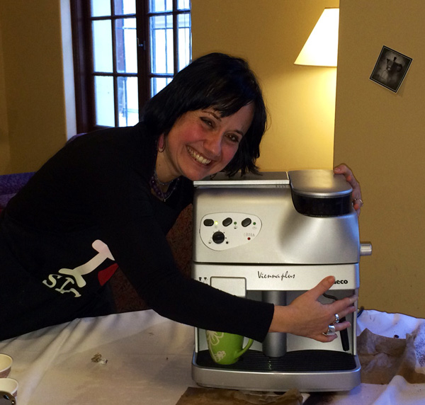 Liliana hugging her beloved cappuccino maker