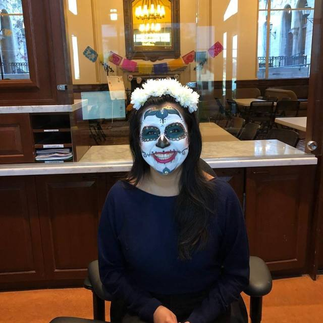 Gemma Givens, Front Desk Operations Coordinator by day, skull face painter at Dia de los Muertos Coffee Hour!
