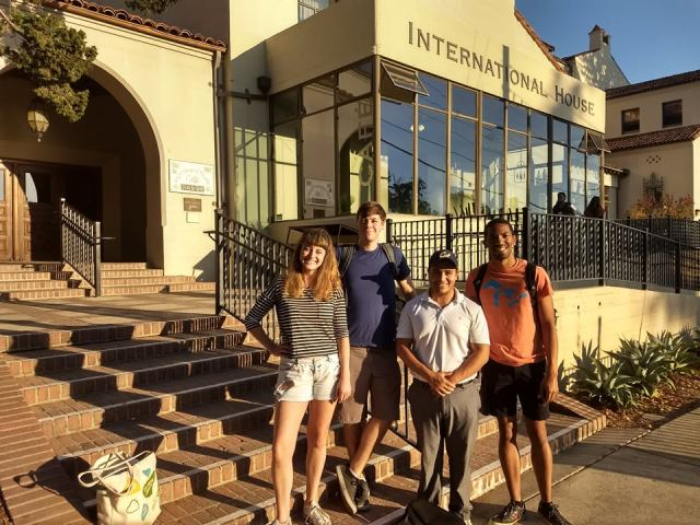 Benny Corona with residents in front of I-House